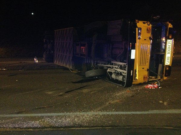 The bus landed on the driver's side, shattering the driver's side windshield and leaving glass and automotive fluid on the road.