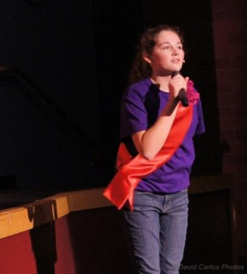 "Kaitlyn Robinson performs performing ""Sufferin' 'Til Suffrage."""