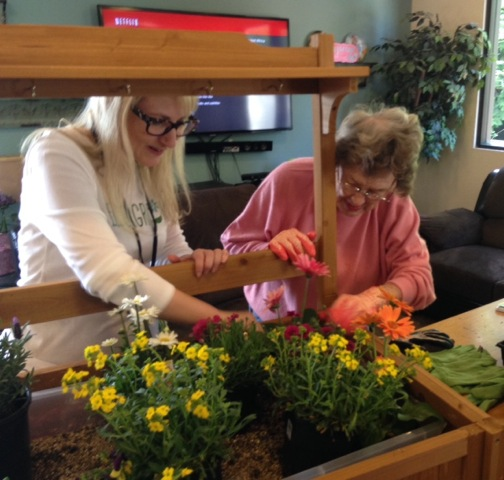 Amy Gregory gets some pointers from a resident on how to design the garden.