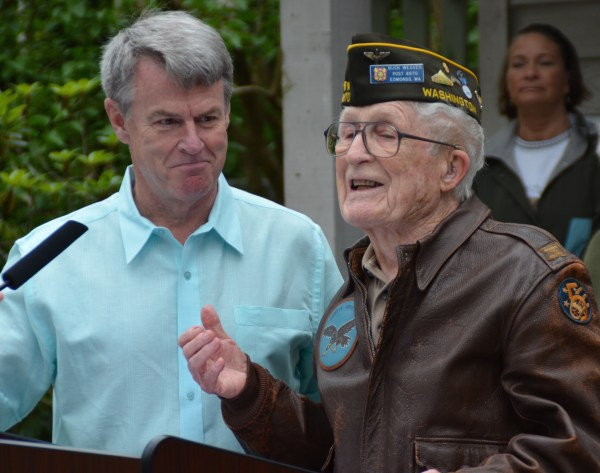 "World War II fighter pilot Robert ""Buck"" Weaver, 96,  is introduced by Memorial Day Ceremony MC Patrick Kelly."