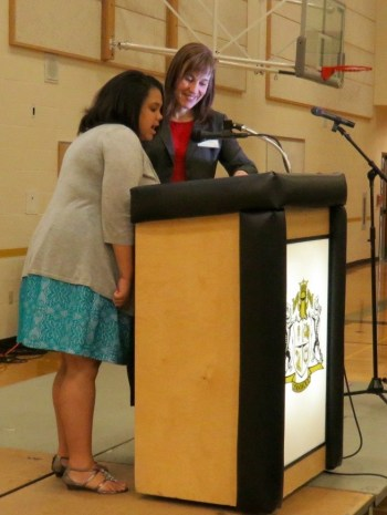 Meadowdale Middle School student Erika Eddings, assisted by Meadowdale Middle Career and College Specialist Julie Jackson, talks about how the after-school study club has helped her.