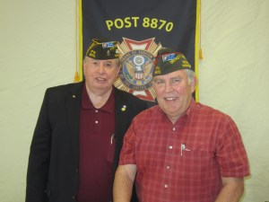 Past VFW Post 8870 Commander Jim Traner, left, congratulates newly installed Commander Jim Blossey.