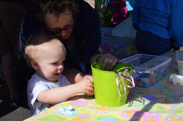 Ewan Clawson, 19 months old, decorates his container with stickers.  According to parents Ben and Kristen Clawson, young Ewan is already quite the gardener.  He has his own set of garden tools at home, and loves helping his parents dig in their home flower beds.