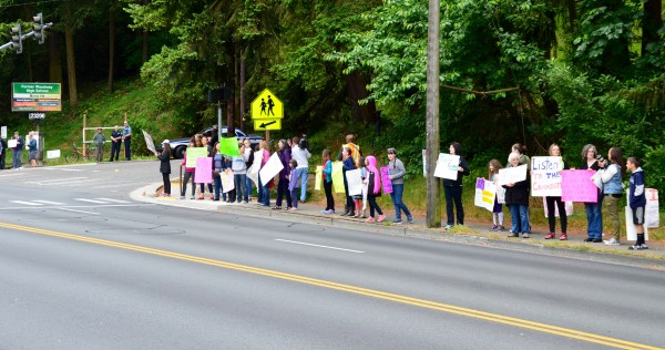 Protesters line 100th Avenue West at the school entrance.