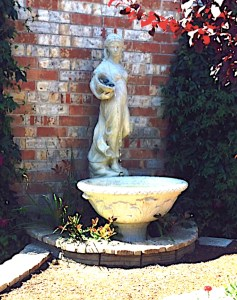 Private residence at 5th Ave. near Bell St.-- This Renaissance inspired fountain depicts a maiden pouring water from a pitcher into a trough.