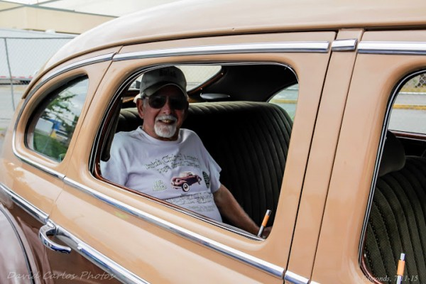 """Jerry Lial, Sr. sits in the back of his 1941 Buick.  He got the car in 1994. """"It took about a year to decide what I wanted to do with it.  And then a little money here, a little money there.""""  The rear seat is original, but the front seats are from a Cadillac. It's got a 350 Chevy engine, and Camaro 4-speed transmission.  """"I wanted it to be MY car,"""" he said."""