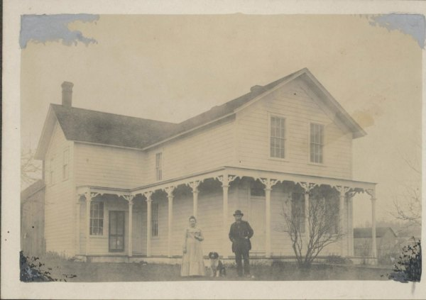 George and Etta Brackett in front of their home at what is now the corner of Second Avenue North and Edmonds Street.