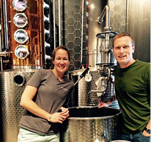 Owners Kim and Bryan Karrick near their gin still.
