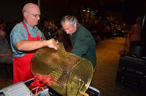 Morris had the honor of drawing the winning raffle tickets,  assisted by Edmonds in Bloom treasurer Ray Anderson.