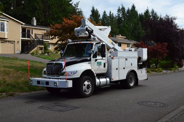 A PUD line truck patrols a circuit in Edmonds Saturday to locate damage and make repairs.