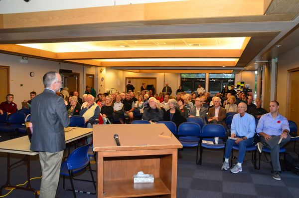 Ross MacFarlane of Climate Solutions addresses a crowd of more than 75 citizens attending the forum.