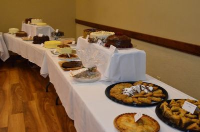 "Last year's ""dessert scramble"" pitted tables against one another for first choice from the dessert table."
