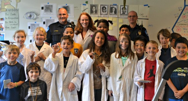 Edmonds police officers visit with Edmonds Heights student.