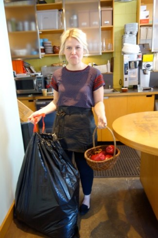 "A grieving Sarah, barista at Walnut Street Coffee, holding the bag containing the remains of Johnny Appleseed. ""It was so senseless,"" she said. ""They didn't even eat the apples."""
