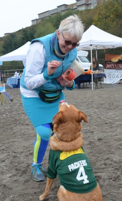 Edmonds City Councilmember Diane Buckshnis, an avid Green Bay Packers fan, with her dog Spike.