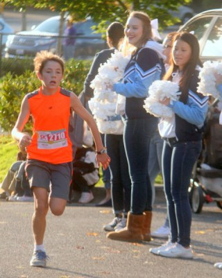 Connor Bryan, 12 of Edmonds, was the first youth finisher in last Saturday's 5k Run. (Photo by David Pan)