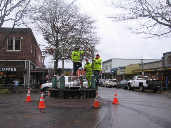 012 Parks crew installing lights at 5th & Main fountain