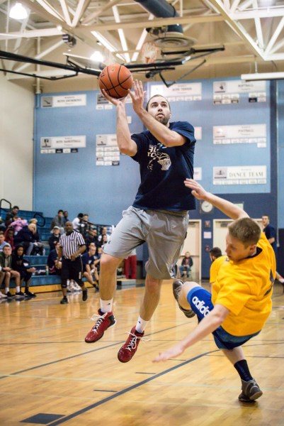 Meadowdale 2008-2010 and new head boys coach, Roger O'Neill (2009), is fouled on the slashing shot.