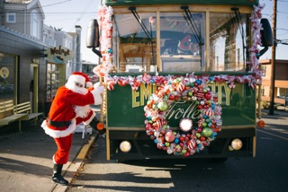 Santa hops on the Holiday Trolley.