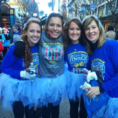 Lauren Little and teammates catch their breath after last year's Jingle Bell Run.