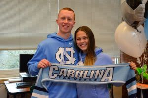 Boyfriend Griffin Small shows his support with a Tar Heels sweatshirt and scarf.