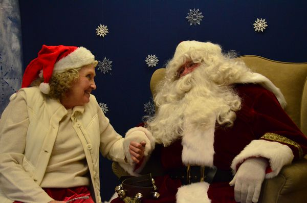 Mr. and Mrs. Claus (Bob and Patti Greene) take time out for each other between shots.