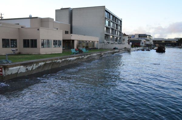 King Tide waters break against the Edmonds Senior Center seawall.  Planners for the new senior center are taking rising water levels into account and raising the planned floor level between two and three feet, according to Senior Center Board President John Osterhaug.