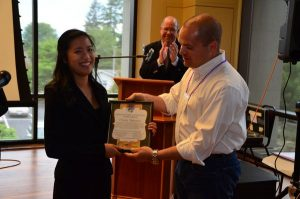 Jamie Reece presenting Cindy Nguyen with a $3,000 scholarship.