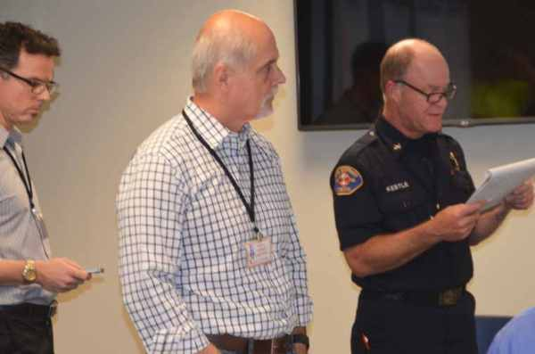 From left, City Clerk Scott Passey, Public Works Director Phil Williams and Fire District Battalion Chief Gary Kestle,