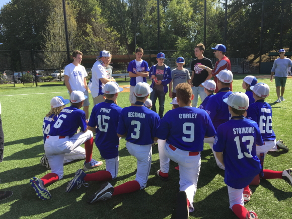 After their win, members of the 2016 team receive advice from Pacific players who went to the World Series in 2014.