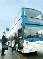 A commuter hops on a double-tall bus. (Photo courtesy Community Transit)