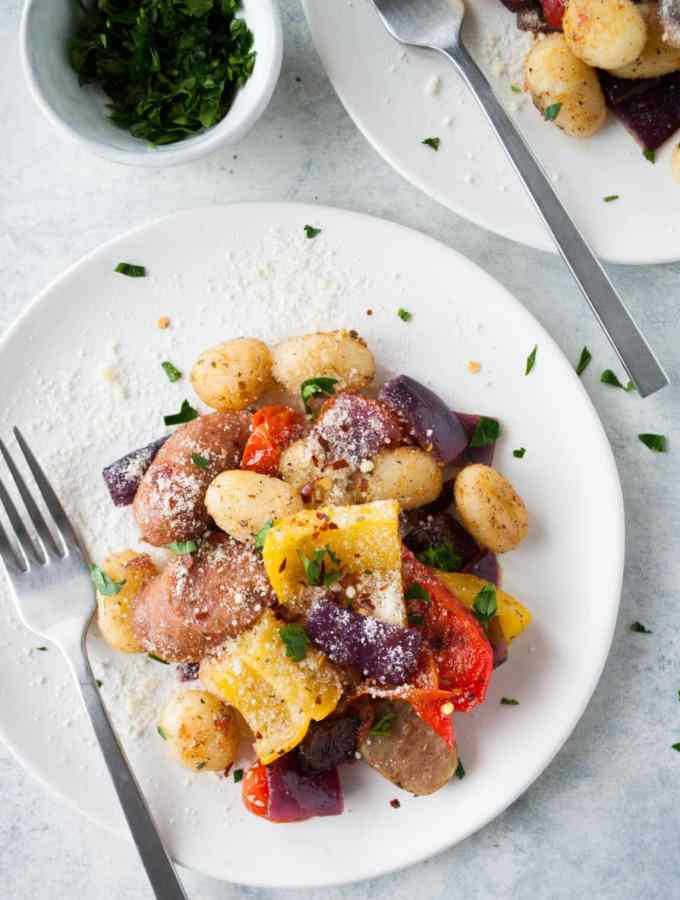 baked gnocchi sheet pan dinner on a plate with fork