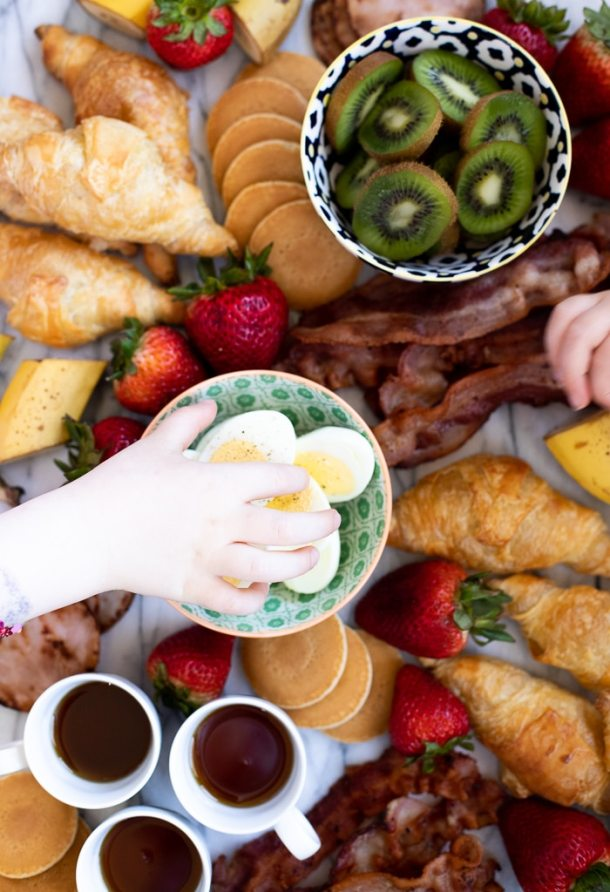 trader joe's breakfast board with hand