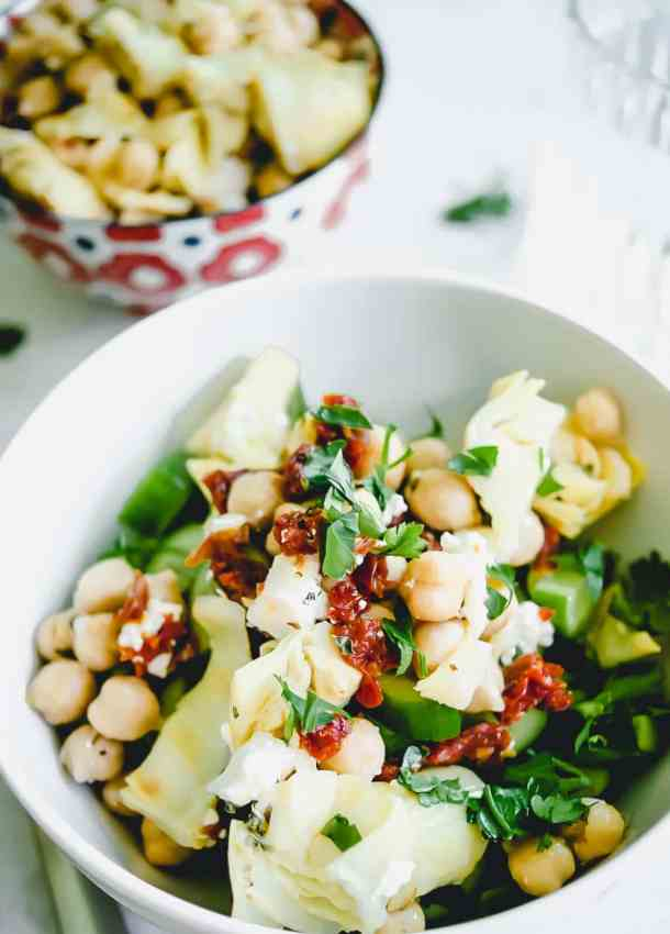 garbanzo bean salad in white bowl