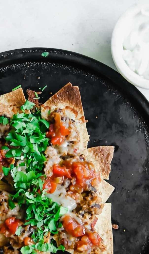 Slow Cooker Turkey Chili Nachos with sour cream