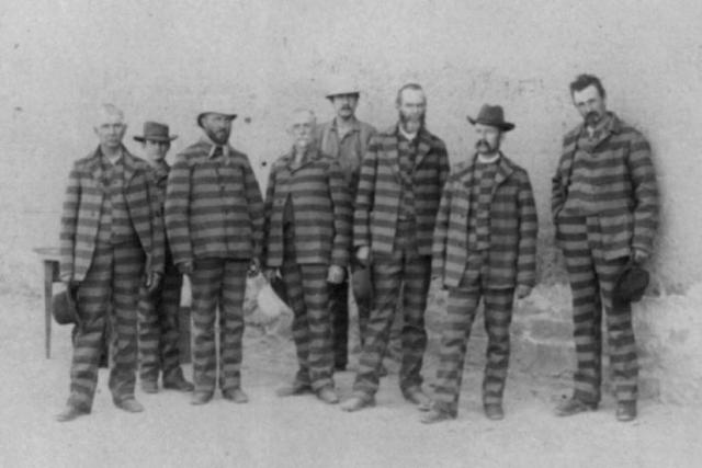 Men in prison stripes