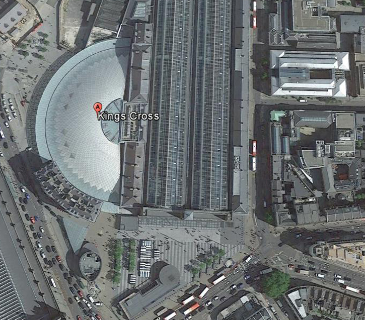 A Google Earth Image of Kings Cross Station. Curved structure (the red placement - Kings Cross) is the Western Concourse. At the lower end of the structure is the curved building of the GNR Hotel. The open space at the lower end is the Kings Cross Square.