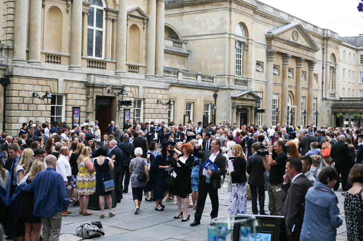 Proud parents mingling at the Abbey Square (outside the Bath Abbey) after attending the Bath Spa University Graduation Ceremony.