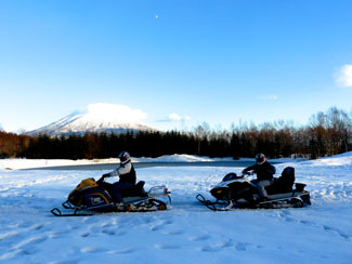 On a snow mobile in Niseko Village in Winter