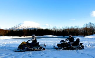 On a snow mobile in Niseko Village in Winter