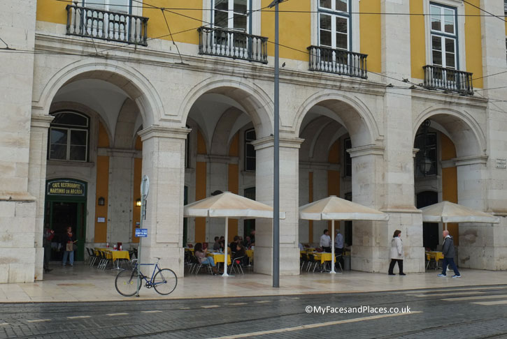Martinho da Arcada is at the North East Corner of the Commercial Square (Praça do Comércio). It is adjacent to a traffic junction