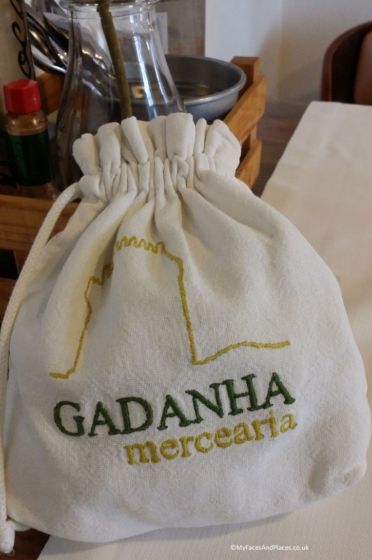 Mercearia Gadanha Restaurant: A rustic country-style take on serving fresh bread in a cotton pouch.