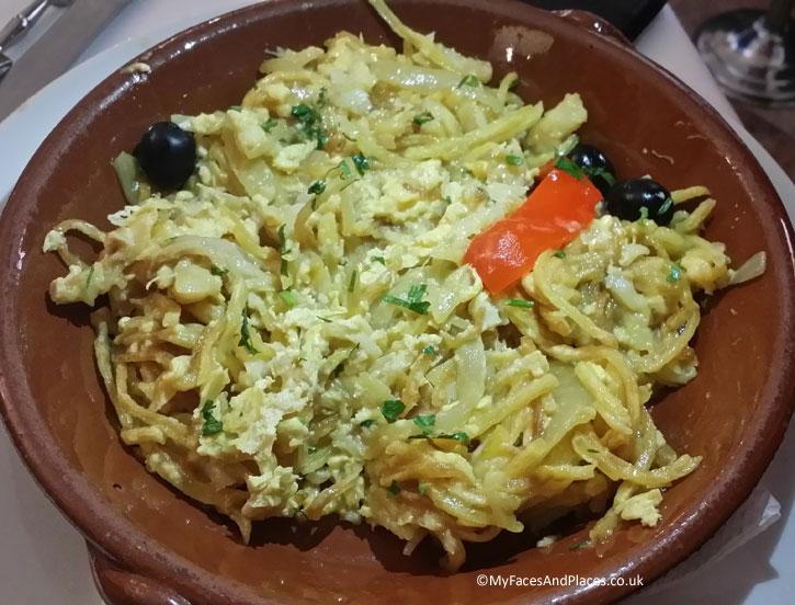 Martinho da Arcada - Bacalhau with shredded potato and cheese. Bacalhau is one of the Portuguese national dishes.