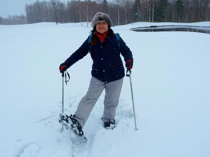 Helen doing some snow walking, She is showing off her snow shoes.