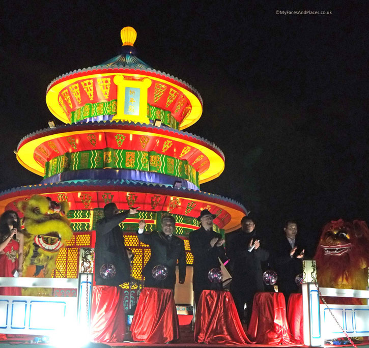 Magical Lantern Festival - The opening Ceremony by the Temple of Heaven Lantern. Note the 2 Chinese lions on either side of the Principals of the ceremony.