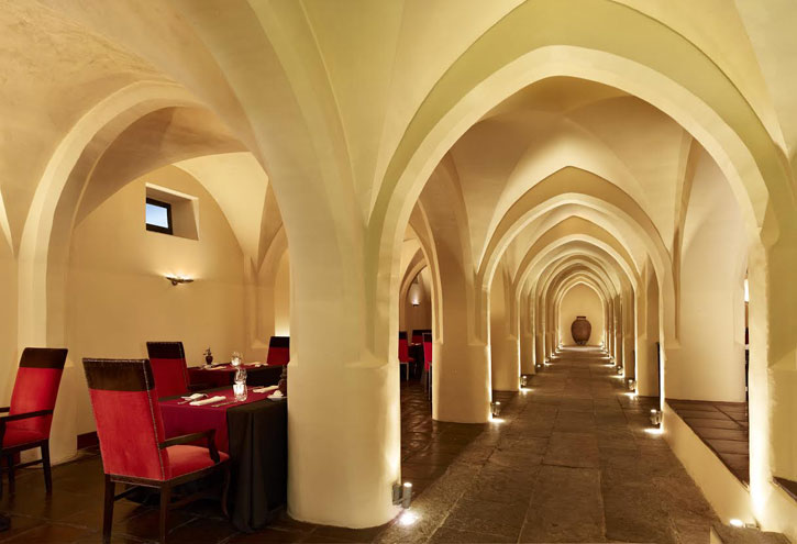 The ancient wine cellar of the monastery is now the fine dining Divinus Restaurant. (image courtesy of Convento do Espinheiro)