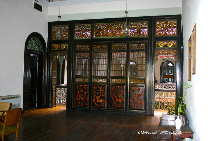 The intricate motifs on the screen panels in the interiors of the Blue Mansion.