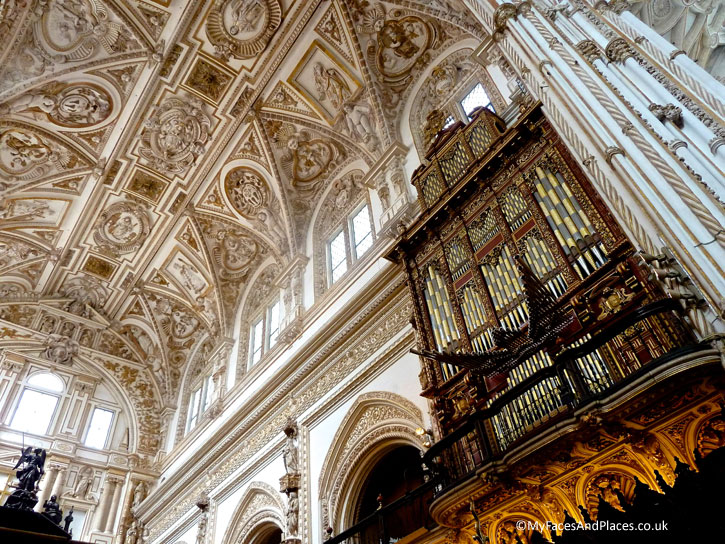 The glorious ornate ceiling of the chapel and the organ inside the Mosque-Cathedral of Cordoba.