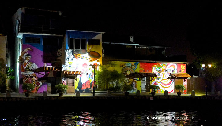 Murals depicting the 3 main races of Malaysia – Indian, Malay and Chinese as seen on the Melaka River Cruise.