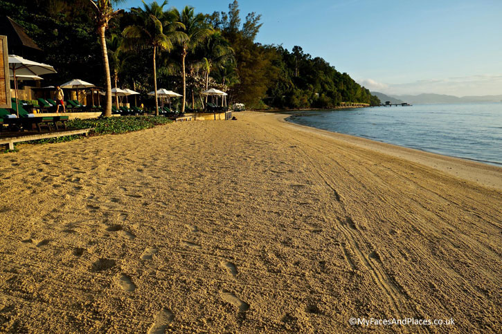 Golden sand hugs the shoreline at Gaya Island Resort
